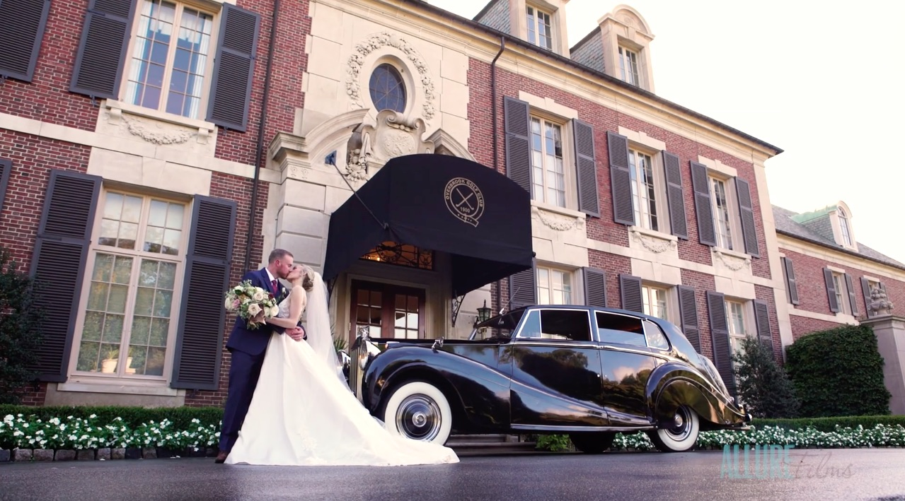Allure Films Captures Bride and Groom Kiss at Overbrook Golf Club