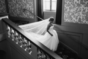 Bride Goes Down Stairs at Overbrook Golf Club